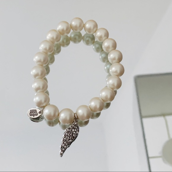 Juicy Couture Jewelry - Juicy Couture Faux Pearl Shine Wing Bracelet NWOT